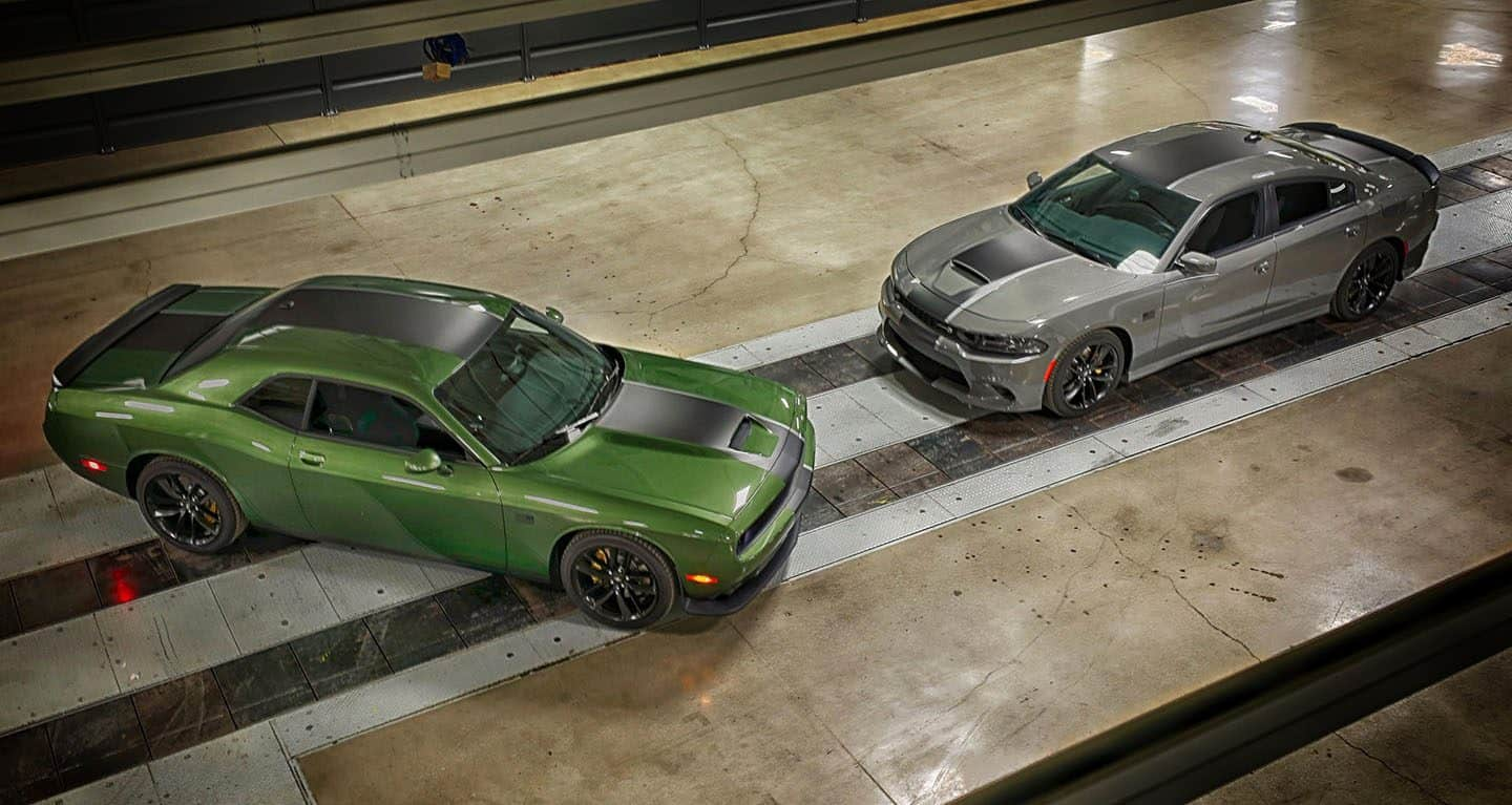 Display An overhead view of a 2019 Dodge Challenger Stars & Stripes Edition and a 2019 Dodge Charger Stars & Stripes Edition.