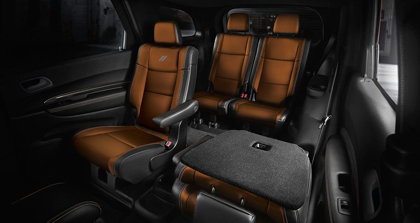 The second- and third-row seats in the 2020 Dodge Durango with the driver-side second-row seatback folded flat.