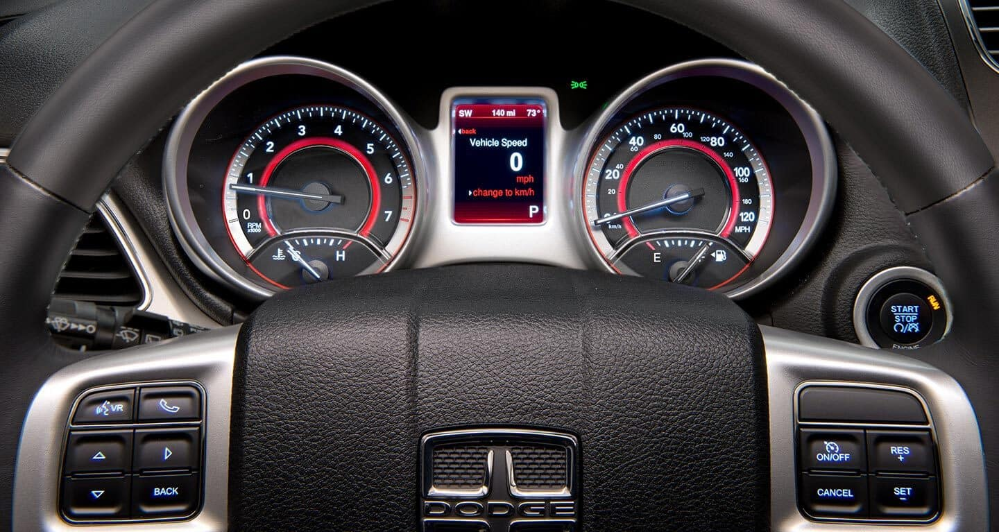 Display The driver information digital cluster display in the 2020 Dodge Journey showing the vehicle at idle.