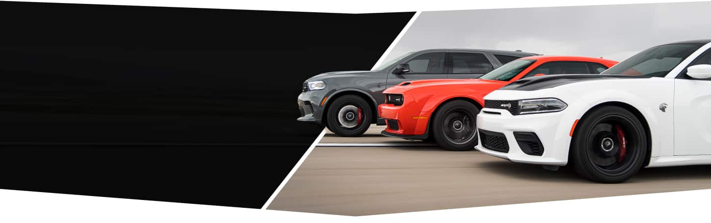 A profile view of the Dodge Brand lineup, from left to right: a gray 2021 Durango SRT Hellcat, red 2021 Challenger SRT Super Stock and white 2021 Charger SRT Hellcat Redeye Widebody.
