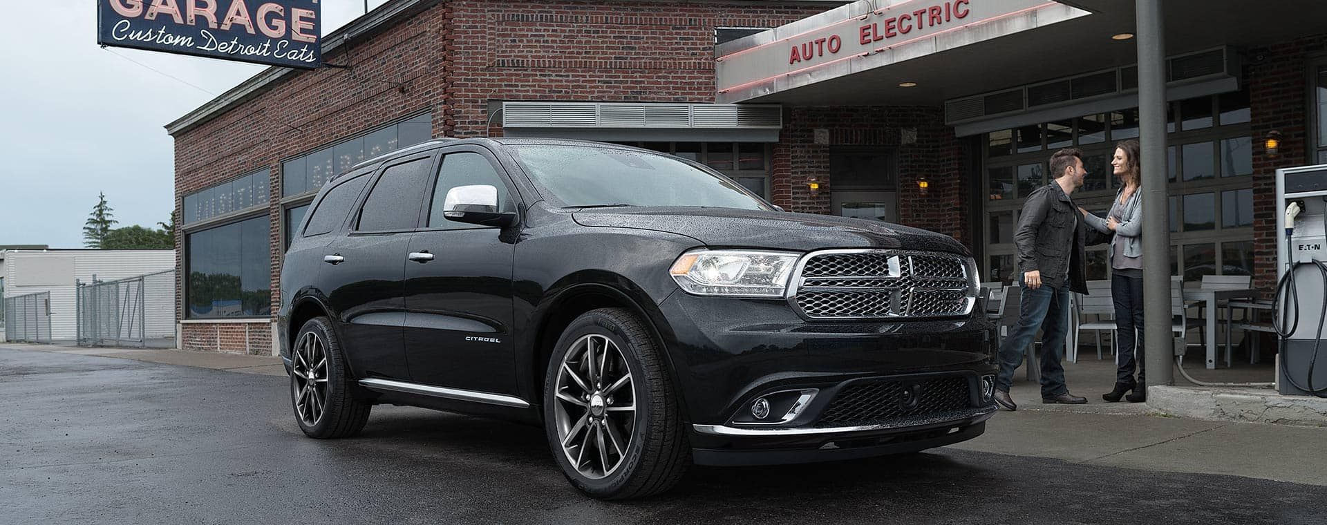 A 2020 Dodge Durango Citadel parked outside a retro-styled mechanic's shop turned restaurant.